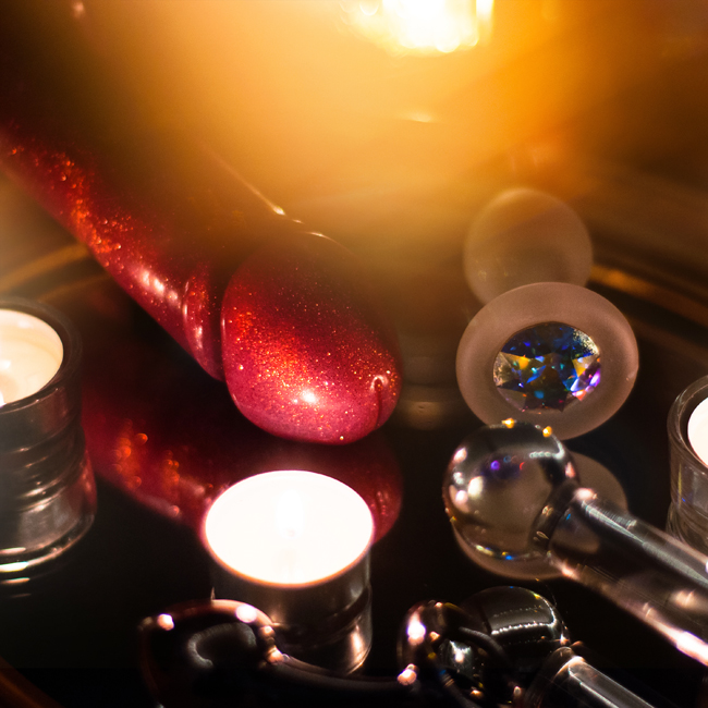 jeweled crystal delights and njoy steel butt plug on a mirror with candles with glittery dildo and glass dildo