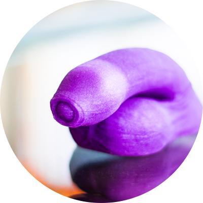 purple silicone uncut Pierre packer on a reflective surface
